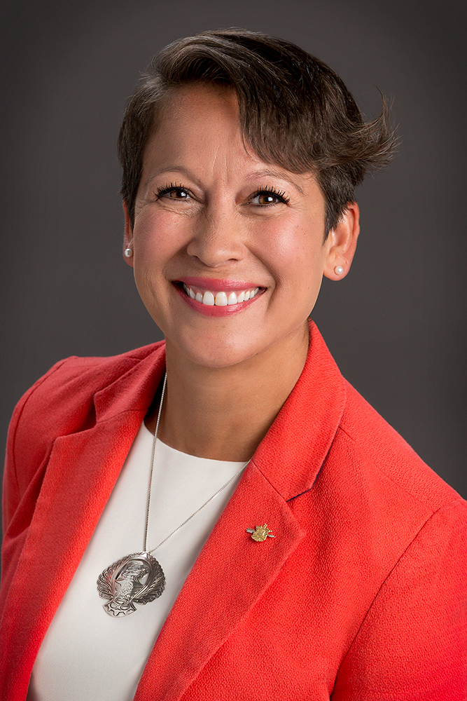 portrait photography bc minister of advanced education melanie mark smiling in orange jacket