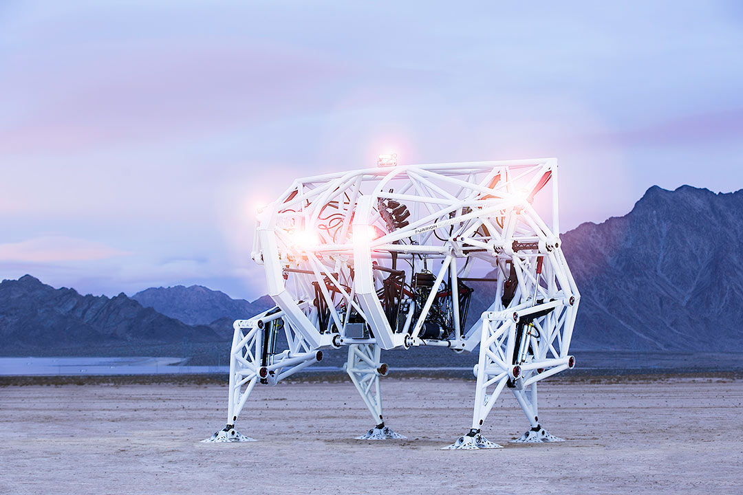 prosthesis, the human controlled, electric walking machine rests in the desert at dawn